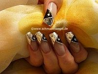 Motif with hologram foil, nail lacquer and strass stone