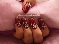 Fingernail motif with glitter-powder and nail art bouillons