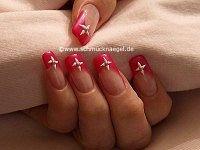Nail art motif with half pearls and nail lacquer