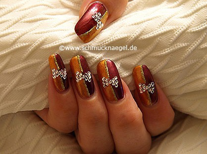 Nail art with strass stones and nail lacquers