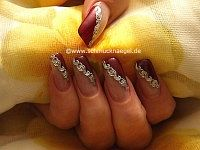 Fingernail motif with nail tattoos