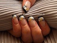 Fingernail motif with beaten gold