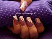 Nail art with strass stones and nail sticker
