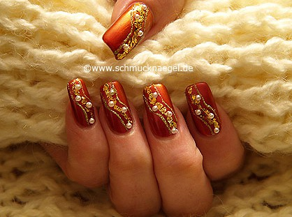Fingernails decorated with beaten gold
