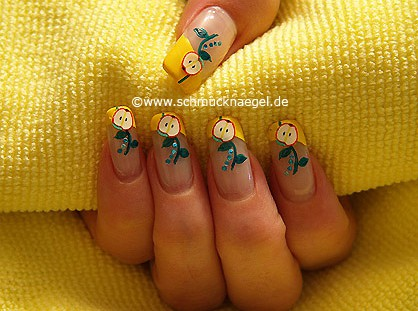Design with nail lacquer in yellow and fimo fruit