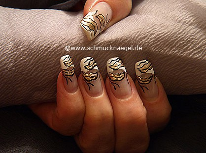 Autumn motif with leaves in the colours gold, black and white