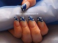 French design fingernail motif with strass stones
