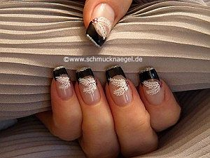 Feather nail art motif with strass stones