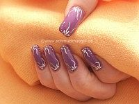 Nail decoration in purple look