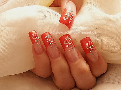 Nail art in bright red with strass stones