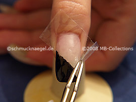 Pinzette und durchsichtiges Klebeband