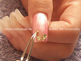 Blattgold und Pinzette