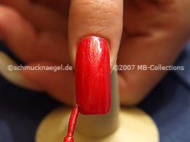 Esmalte en rojo claro con glitter