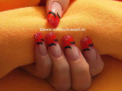 Polvo en rojo-glitter y esmalte en naranja oscuro
