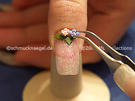 Pinzeta y flores ceramicas