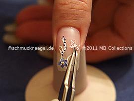 Mariposa tridimensional y pinzeta