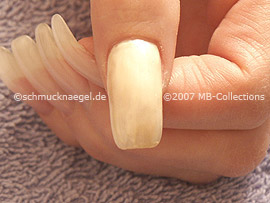 Nail polish in the colour bright beige