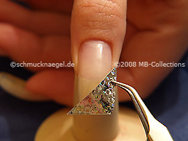 Hologram foil in silver and tweezers