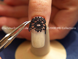 Lace border and the tweezers
