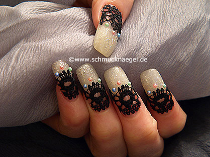 Fingernail motif with nail art lace border and pearls