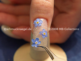 Dry flowers and tweezers