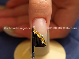 The clear nail lacquer protects the nailart