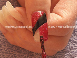Nail polish in the colour red-glitter