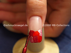 Nail polish in the colour dark red