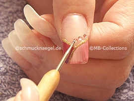 Clear nail lacquer, spot-swirl and strass stones