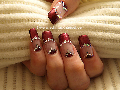 Decorated fingernails with strass stones