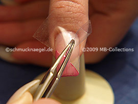 Tweezers and clear adhesive tape