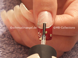 clear nail polish, spot-swirl or toohtpick and strass stones in red
