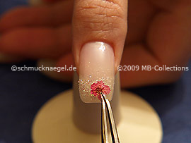 Tweezers and dried flower