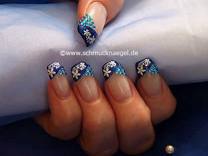 Strass stones and nail lacquer in blue