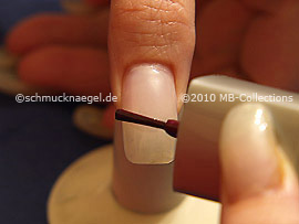 Nail lacquer in the colour aubergine