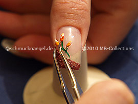 Dried flower and tweezers