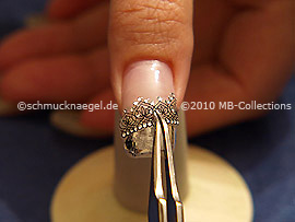 3D nail art sticker and the tweezers