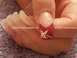 spot-swirl or a toothpick, strass stone and nail art pen in white
