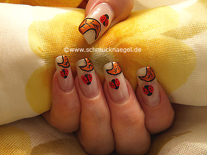 Ladybird as fingernail motif with nail art liner