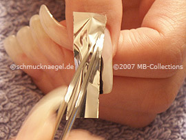 tweezers and the metallic foil in silver