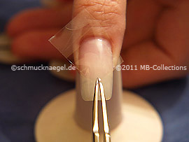 Clear adhesive tape and tweezers
