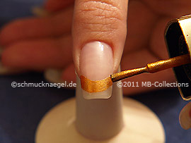Nail lacquer in the colour brown with glitter particles