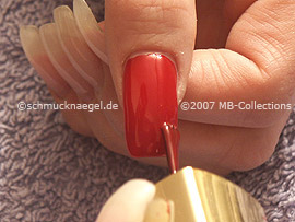Nail polish in the colour red