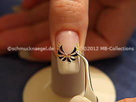 Nail art sticker with strass stones and the tweezers