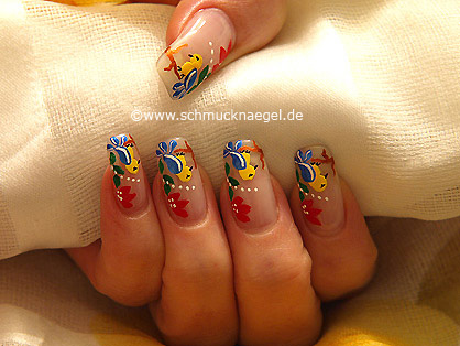 Bird as fingernail motif with nail lacquer