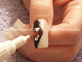 nail art pens in the colours red, white, silver and bronze
