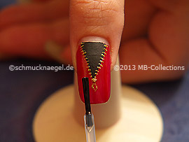 The clear nail lacquer protects the nail art