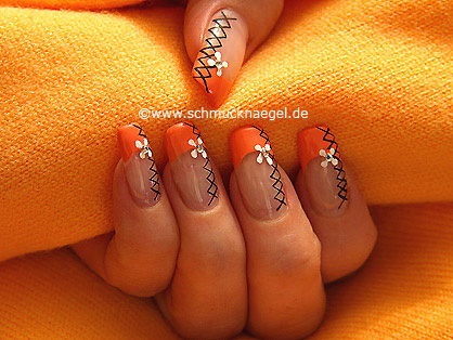 Salmon colored fingernail motif with strass stone
