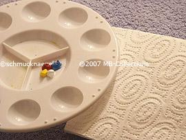 acrylic colours, colour mixed pallet an a paper napkin