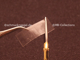 clear adhesive tape, tweezers and cutter